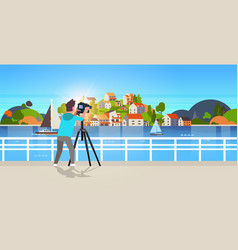 Man travel photographer taking nature picture vector