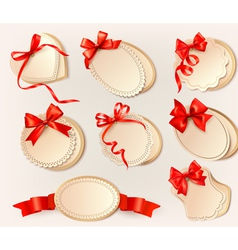 Set of beautiful retro labels with red gift bows vector image vector image