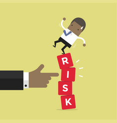 african businessman standing on shaky risk blocks vector image