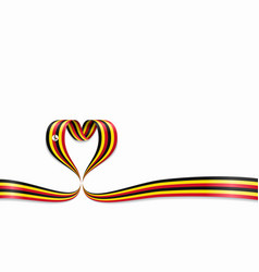 Ugandan flag heart-shaped ribbon vector