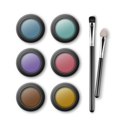 set of multicolored eye shadows with applicators vector image