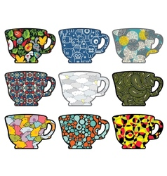 Set of tea cups with cute patterns vector image