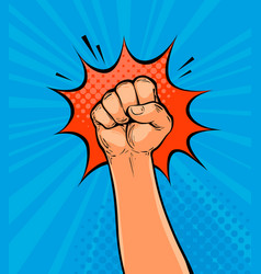 Raised up clenched fist drawn in pop art retro vector