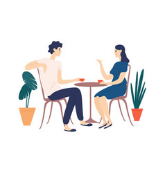 cute couple sitting at table drinking tea or vector image