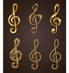 Set of golden decorative treble clef vector