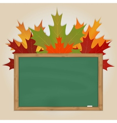 Maple leaves on green chalkboard vector image