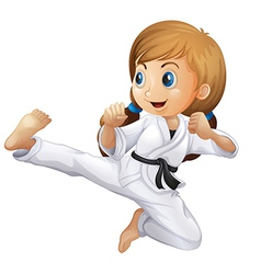 A young girl doing karate vector