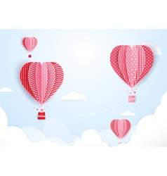 Hot air balloons in shape of heart flying vector image