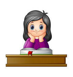 school girl with textbook at desk vector image