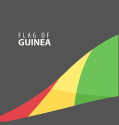 flag of guinea against a dark background vector image vector image