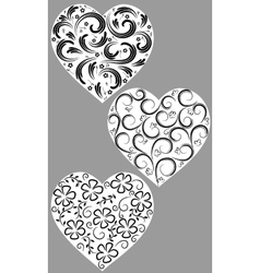 Three hearts from curls vector image