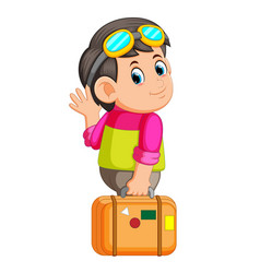 young man holding travel bag and waving hello vector image