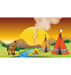A camp fire and the sunset vector image
