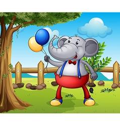 An elephant holding balloons vector