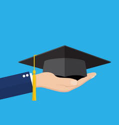 Hand holding graduation cap vector