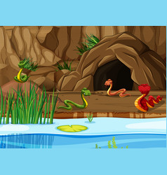 Lake and cave scene with snakes vector