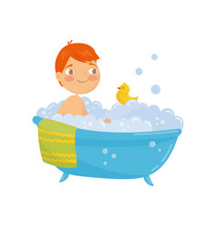 funny red-haired boy taking bath with rubber duck vector image