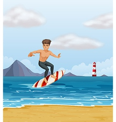 A boy surfing at the beach vector