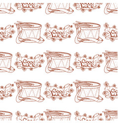 Seamless pattern with drum and banner of good luck vector