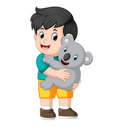 a little boy holding koala vector image