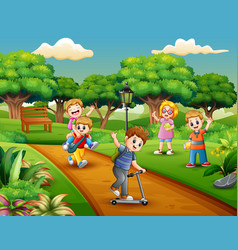 Cartoon group of children playing in the park vector
