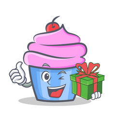 Cupcake character cartoon style with gift vector