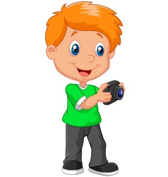 Little boy holding a camera vector