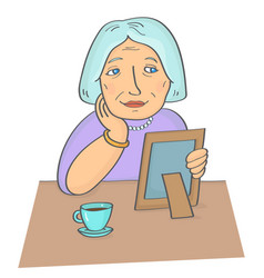 elderly woman holding photo frame vector image