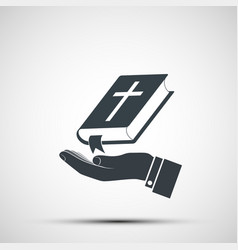 priests hand holds holy bible vector image