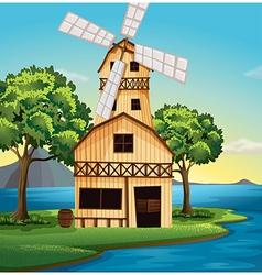 A farmhouse with windmill vector