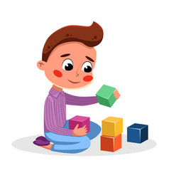cute adorable little boy playing with colorful toy vector image