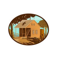 Cajun house and gator oval wpa retro vector