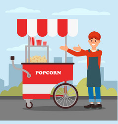 friendly seller standing near popcorn cart street vector image