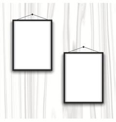 Blank frames on wood background vector