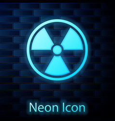 Glowing neon radioactive icon isolated on brick vector
