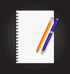 notebook on it pen and pencil a black background vector image