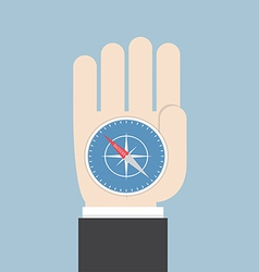 Businessman hand holding a compass that points to vector image