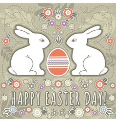 Greetings card with easter eggs and two rabbits vector