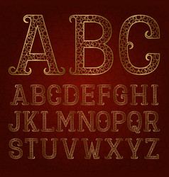 golden ornamental letters with flourishes on red vector image