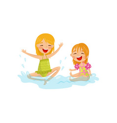 Cheerful kids making water splashes two little vector
