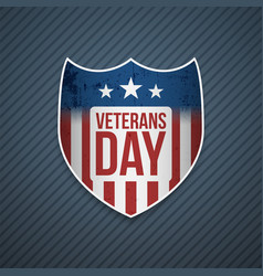 Veterans day text on realistic emblem vector