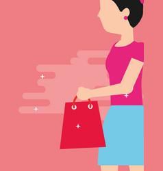 woman holding shopping bag walking vector image