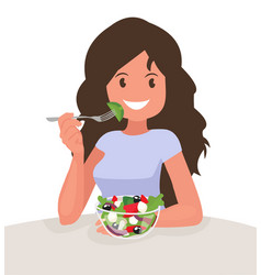 Happy woman is eating a salad vegetarian vector
