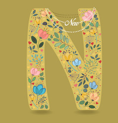 yellow letter n with floral decor and necklace vector image
