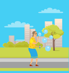 aged woman with soap bubbles in city park town vector image