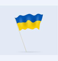 ukraine flag on flagpole waving in wind vector image