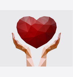 Human hands holding polygonal heart vector