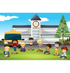 Children standing in front of school vector image