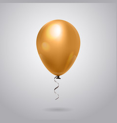 beautiful golden balloon with ribbon on grey vector image