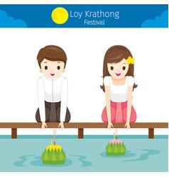 Loy krathong festival boy and girl floating vector